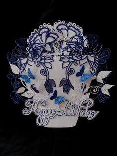 Birthday Flower pot Card CraftROBO Cameo on Craftsuprint designed by Tina Fitch - made by Marion Enefer - A truly beautiful file making a stunning card. Cut out on Cameo using 250gsm white card and 160gsm pearlescent dark blue card. Assembled card which needs a little bit of patience but is well worth the effort. Finished off with two silver sparkly buttons in middle of two top flowers and three small matching blue embossed butterflies. A wonderful card to give to anyone . - Now available…