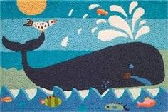 A birds eye view of the worlds largest mammal is delightfully portrayed on this doormat. And a few fish-y friends get blown away with excitement! Jellybean mats are extremely useful for summer entrances and what fun for doorways leading pool or beach! Indooroutdoor doormats are part of a collection of rugs designed by many well known artists. Special patented construction keeps poly-blend twisted yarns in a hooked technique which prevents picking or pulling.