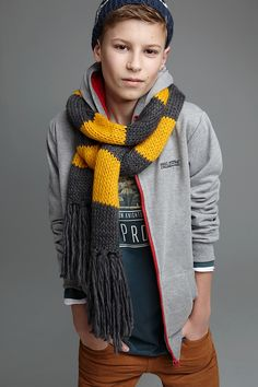 Boys fashion, teen style. Keeping casual cool for fall, winter & spring. Chunky stripe scarf, colored pants.