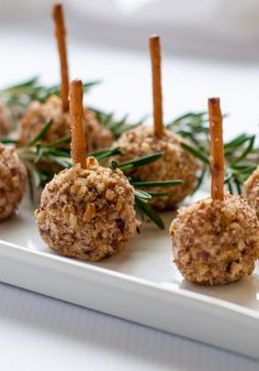 Mini Cheese Balls on a Stick--fun finger food! A tiny bite on a pretzel stick. Easy to make gluten-free, too! |www.flavourandsavour.com