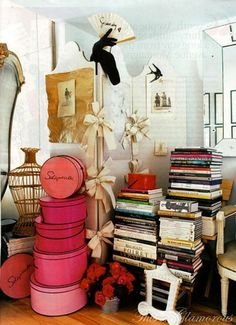 hat boxes | stacked books