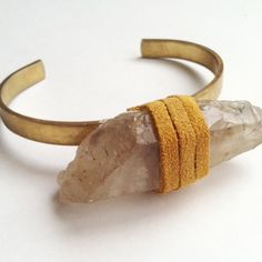 Large Chunk of Smokey Quartz Wrapped in Camel Colored Leather on a Brass Cuff.  $49.00  #quartz #smokey #cuff #bracelet #Bangle #unique #raw #stack #armcandy #armswag #armparty #jewelry #accessories #ooak #boho #crystal
