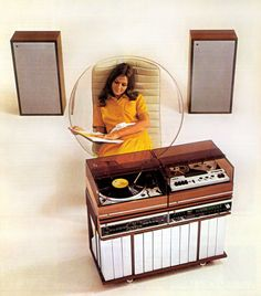 Sitting. And listening. Early seventies style. It seems to be that the word was biggest is best #70s