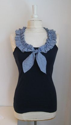 With the nautical trend on high gear this season, I love this nautical-inspired shirt refashion using a simple $5.50 navy tank top as the base.