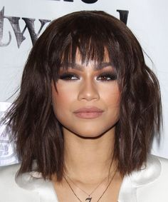 Zendaya Coleman Medium Straight Hairstyle. Try on this hairstyle and view styling steps! http://www.thehairstyler.com/hairstyles/casual/medium/straight/zendaya-coleman