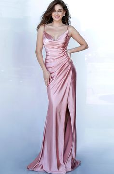Jovani JVN 03104 is a long fitted satin prom dress with an asymmetrical ruched bodice and classy cowl neckline. High Thigh split with a small train in the back. Available Colors: Dusty Pink Available Sizes: 00 (In Stock) Straps Prom Dresses, Jovani Dresses, Satin Dresses, Classy Prom Dresses, Pageant Dresses, Wedding Dresses, Damas Rose, Pretty Dresses, Beautiful Dresses