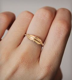 I love delicate layering rings like this little golden feather