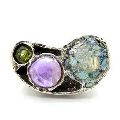 Silver ring with roman glass amethyst and a peridot by Hadas1951
