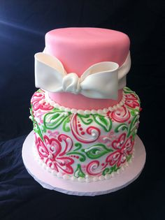 Beautiful pink, green and white tiered cake with bow.  The bottom tier could easily be done in buttercream.
