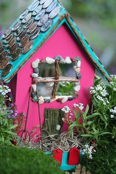 A really cute fairy garden! Penny's on the roof for shingles, and tiny pebbles framing the windows. Love it!