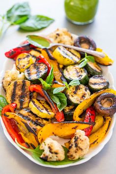 Grilled Vegetables with Basil Vinaigrette - Grilling gives these simply prepared vegetables the perfect amount of SMOKY flavor!! The basil vinaigrette is LOADED with layers of flavor and ready in 1 minute! Healthy, fast, EASY, minimal cleanup = the PERFECT recipe!!