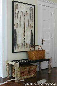 Love this giant shadowbox of feathers and the woven bench and baskets in this foyer eclecticallyvintage.com