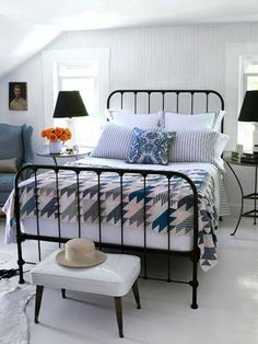 Weirdest thing ever: I have almost that same bed and that same cushioned stool! Cute styling.