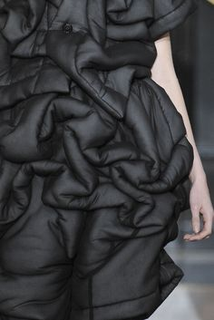 Quilted Elegance - black dress with padded patterned texture; sculptural fashion // comme des garçons a/w10