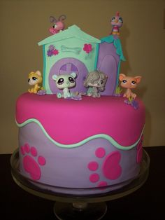 """Littlest Pet Shop Cake My Daughter's 5th Birthday cake. 10""""vanilla cake (I added food colouring for a rainbow effect). A small..."""