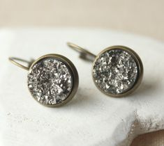 I just love these dark grey faux druzy earrings, very wearable, lightweight 12mm cabochon earrings, available as pierced leverback dangles or as Clip On drop Earrings, silver plated, rose gold, antique brass or yellow gold, choose at checkout. (see thumnail for metal tones)  These earrings measure 12mm (1/2) across 5mm deep, they just hang below the earlobe, each surface is different, shimmering multi faceted. Made with resin, so lighter than heavy Druzy stone ones, my husband is a geolo...