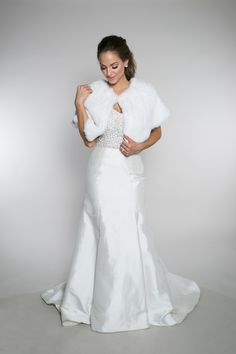 'Coco Marie + Beyoncé Bodice + Sugar Shawl' This timeless trumpet gown elongates and flatters all figures. It features princess seams, a natural waist, low-back, and a chapel train. This bodice is perfect for the bride looking for elegant sparkle. Layer it over one of our many silhouettes to finish your bridal look. The Sugar Shawl features the softest and most realistic feel for this faux rabbit fur shawl. | Bride | Wedding | Wedding Gown | Wedding Dress | Pretty Wedding | Engaged |