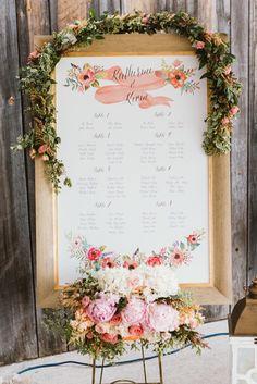 Wedding table plan with fresh flower garland decoration