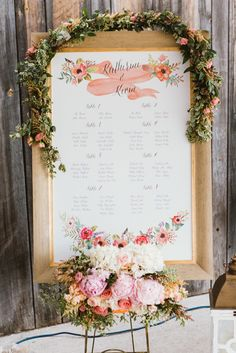Beautiful customized seating chart decorated with hand-painted florals, whimsical script and an elegant gold frame   Studio Finch Photography