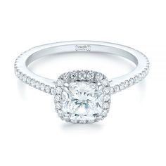 This dazzling engagement ring features a cushion cut diamond in the center of a split prong set diamond halo, all of which is accented by additional. Most Popular Engagement Rings, Design Your Own Engagement Rings, Alternative Engagement Rings, Perfect Engagement Ring, Halo Diamond Engagement Ring, Thing 1, Cushion Cut Diamonds, Diamond Solitaire Rings, Diamond Cuts