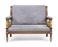 AN EMPIRE BRASS-INLAID PARCEL-GILT MAHOGANY SOFA. CIRCA 1810, AFTER A DESIGN BY PERCIER & FONTAINE, POSSIBLY RUSSIAN