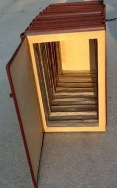get an entire series like Encyclopedia Brittanica or something and make a big hidden storage space!