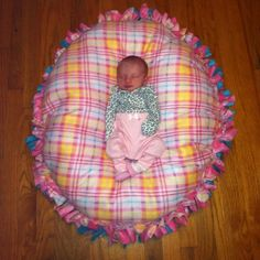 No-sew floor pillow pouf, made just like a tie fleece blanket but stuffed with poly-fil. Awesome baby gift!!!