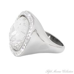 Très Jolie - Keep them guessing wearing this magnificent ring, centered with a large full cut cubic zirconia surrounded by 40 sparkling clears set in popular stainless steel finished in rich rhodium.