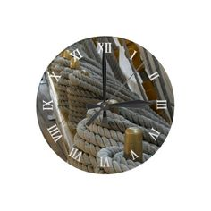 Unique, trendy, decorative and pretty wall clock. With image of ropes on the bridge of a ocean frigate. Nautical design made for the sailor, boat captain, boater, water sport, boating, sailing, ocean or sea lover. Cute mom's or dad's birthday present, Mother's or Father's day, or Christmas gift. Original, cool and fun art for the master or children's bedroom, man cave, family room, cabin, boat or yacht, beach house, vacation home, or office. Design also available on pillow, mug and canvas…