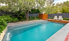 Leisure Pools Sydney grey pool charcoal fence and deck to edge pool landscaping Backyard Pool Landscaping, Backyard Pool Designs, Pool Fence, Backyard Ideas, Fence Ideas, Pool Paving, Concrete Pool, Swimming Pool Decks, Swimming Pool Designs