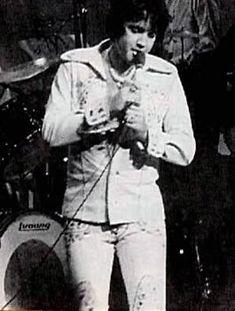 "Elvis Presley In Concert   at the Las Vegas Hilton; wearing the Mermaid/""Nymph"" two piece beige suit."