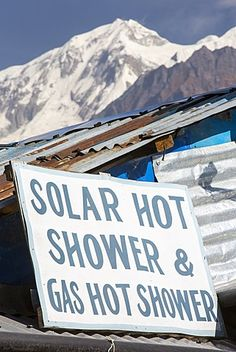 A tea house advertising a hot shower powered by solar thermal panels, Himalayas…