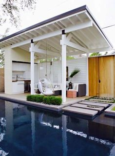 Outdoor kitchen, hanging seat, steps through the pool