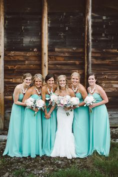Amazing aqua gowns: http://www.stylemepretty.com/canada-weddings/2015/01/22/rustic-hazelnut-orchard-wedding-in-abbotsford-british-columbia/ | Photography: Whitney Krutzfeldt - wckphotography.com