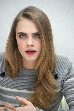 Cara Delevinge. Hair color is similar to my natural color. I like the length and layers. And the gray sweater, because we all know gray is the best color. <3