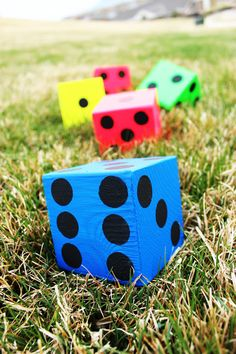 Get ready for the perfect outside game for kids or adults with this lawn Yahtzee dice DIY tutorial and free printable Yahtzee score card.