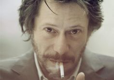 Mathieu Amalric smoking a cigarette (or weed)