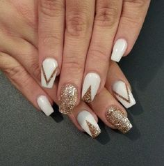 Amazing looking white and gold nail art design. The nails are painted in white nail polish with glitter gold polish that form the v shapes.