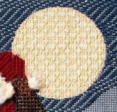 The moon is one of the last items I stitched. I needed Santa's stitches to help anchor the Kreinik #8. I used an open stitch called the ...