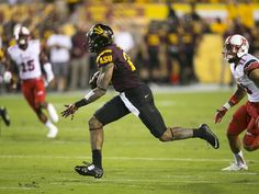 ASU wide receiver Jaelen Strong carries the ball in