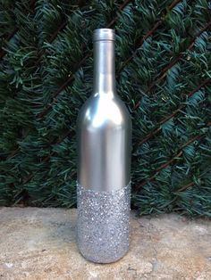 Beautiful gold glitter wine bottle perfect as a centerpiece for a wedding, bridal shower, or any other special event. These are 750ML wine