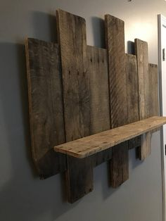 Beautiful wall shelf made from 7 pallets (4 different lengths) with rounded edges and a 31 long shelf. This is a large shelf measuring aprroximately 38 3/8 wide by 33 1/8 long. This is perfect for a bedroom above a dresser or bed. It can also be hung in your dining room, bathroom,