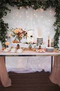 Wedding cake table idea with beautiful fabric draping + greenery backdrop #weddingdecorations #weddingreception #fabricdraping