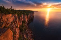 """Superior Vista - """"Superior Vista"""" – Palisade Head, Silver Bay, MN <a href=""""https://www.instagram.com/theworldexplored"""">Instagram</a> II <a href=""""https://www.facebook.com/TheWorldExplored"""">Facebook</a> II <a href=""""https://www.etsy.com/shop/theworldexplored"""">Print Shop</a> A gorgeous sunrise at Palisade Head, overlooking Lake Superior. Interested in seeing more of my work? Check out my new website:<a href=""""http://www.theworldexplored.com"""">TheWorldExplored</a>"""