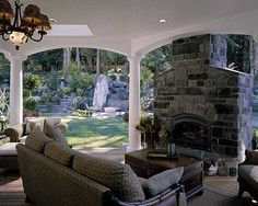 outdoor room. Make that fireplace two sided and put it on a deck that goes under the sofa out to the other side.