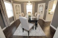 Love the gray walls and white upholstered chairs!