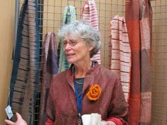 """A World of Natural Dyes: The ISEND Experience. Catherine Ellis, artist and author of """"Woven Shibori"""", in the ISEND marketplace."""