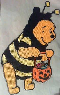 Wanted to make something for Halloween, so here's Pooh dressed as a bee, ready to trick or treat.