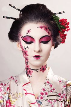Playing a Geisha Airbrush makeup inspired by a traditional Japanese style of theater - Kabuki - a thick white electric face to create a dramatic look with classic black lines to define the character. airbrush editorial kabuki makeup japanese theater makeup avant garde olya tizer artistdeglamour white face sakura pink lip flora