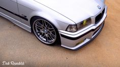 Silver BMW e36 on OEM BMW Styling 65 wheels